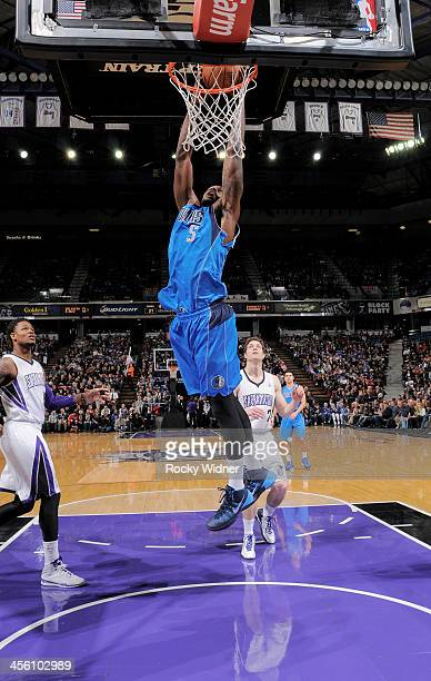 Bernard James of the Dallas Mavericks dunks against the Sacramento Kings on December 9 2013 at Sleep Train Arena in Sacramento California NOTE TO...