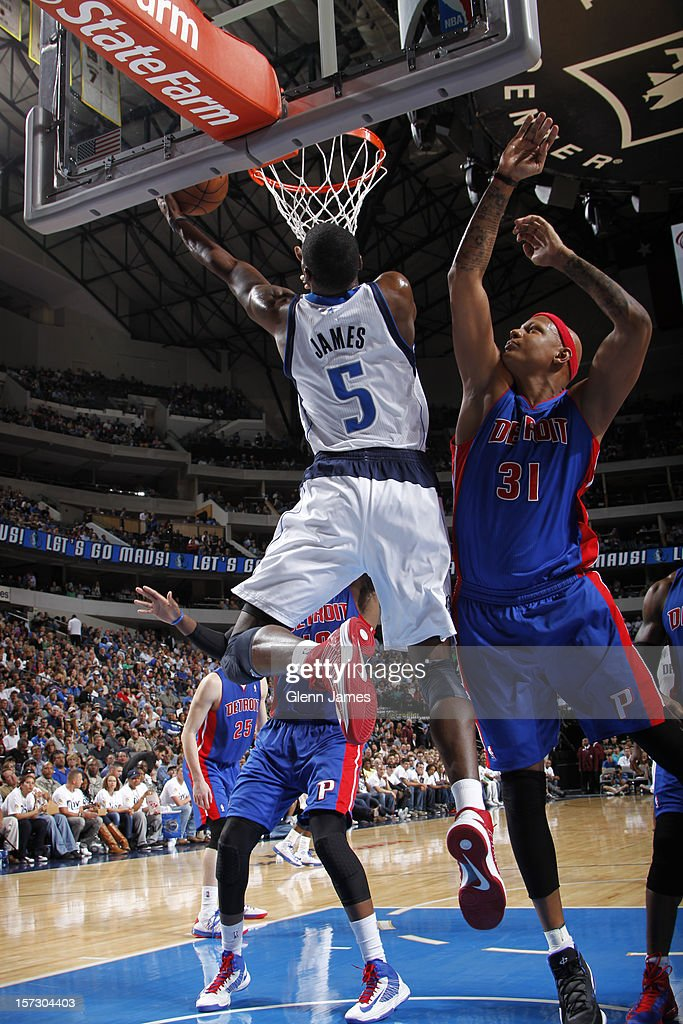Bernard James #5 of the Dallas Mavericks goes in for the reverse against Charlie Villanueva #31 of the Detroit Pistons on December 1, 2012 at the American Airlines Center in Dallas, Texas.