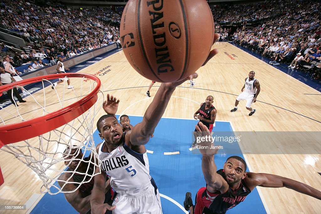 Bernard James #5 of the Dallas Mavericks goes up for the tip in against Alan Anderson #6 of the Toronto Raptors on November 7, 2012 at the American Airlines Center in Dallas, Texas.