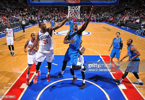 Bernard James of the Dallas Mavericks grabs the rebound against the Philadelphia 76ers at the Wells Fargo Center on February 21 2014 in Philadelphia...