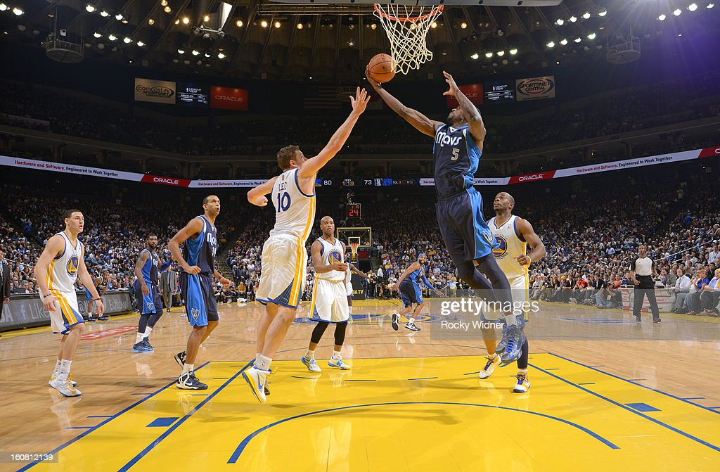 Bernard James #5 of the Dallas Mavericks rebounds against David Lee #10 of the Golden State Warriors on January 31, 2013 at Oracle Arena in Oakland, California.