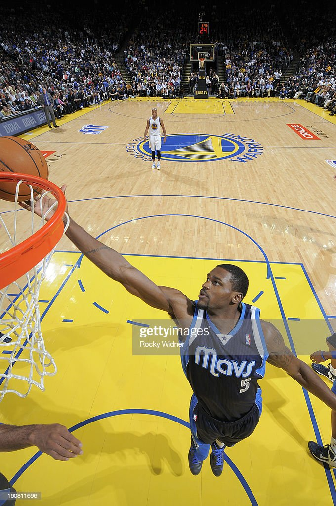 Bernard James #5 of the Dallas Mavericks rebounds against the Golden State Warriors on January 31, 2013 at Oracle Arena in Oakland, California.