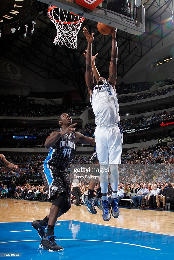 Bernard James #5 of the Dallas Mavericks rebounds the ball against Andrew Nicholson #44 of the Orlando Magic on February 20, 2013 at the American Airlines Center in Dallas, Texas.