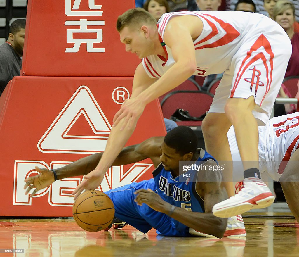 Bernard James (5) of the Dallas Mavericks scrambles for a loose ball against Cole Aldrich (31) of the Houston Rockets in the second half of the Mavericks' 116-109 victory on Saturday, December 8, 2012, in Houston, Texas.