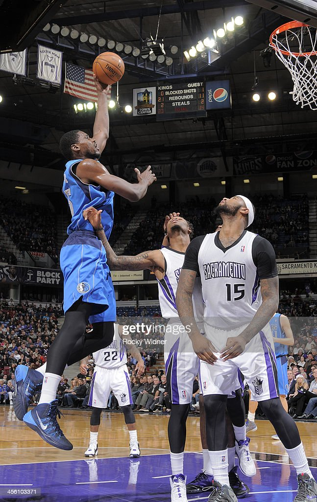 <a gi-track='captionPersonalityLinkClicked' href=/galleries/search?phrase=Bernard+James&family=editorial&specificpeople=7387529 ng-click='$event.stopPropagation()'>Bernard James</a> #5 of the Dallas Mavericks shoots against Ben McLemore #16 of the Sacramento Kings on December 9, 2013 at Sleep Train Arena in Sacramento, California.