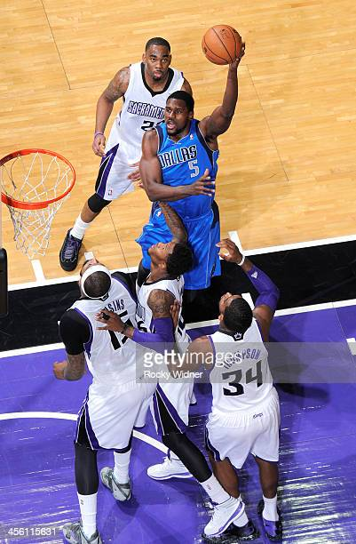 Bernard James of the Dallas Mavericks shoots against Ben McLemore of the Sacramento Kings on December 9 2013 at Sleep Train Arena in Sacramento...