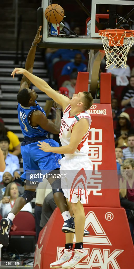 Bernard James (5) of the Dallas Mavericks shoots against Cole Aldrich (31) of the Houston Rockets in the second half of the Mavericks' 116-109 victory on Saturday, December 8, 2012, in Houston, Texas.