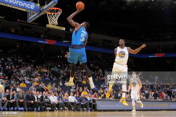 Bernard James of the Dallas Mavericks shoots against the Golden State Warriors on March 11 2014 at Oracle Arena in Oakland California NOTE TO USER...