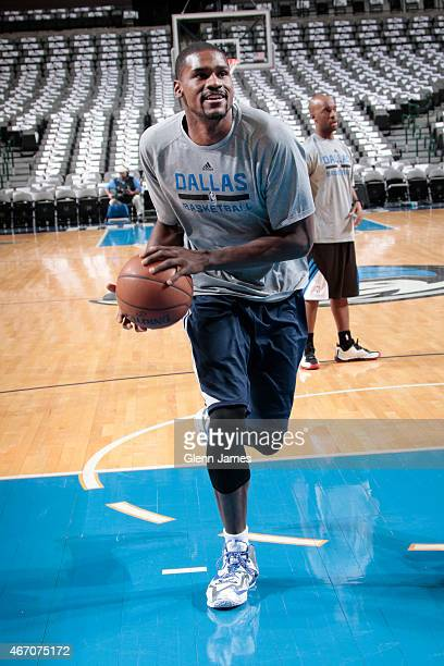 Bernard James of the Dallas Mavericks shoots during pregame warm ups against the Memphis Grizzlies on March 20 2015 at the American Airlines Center...