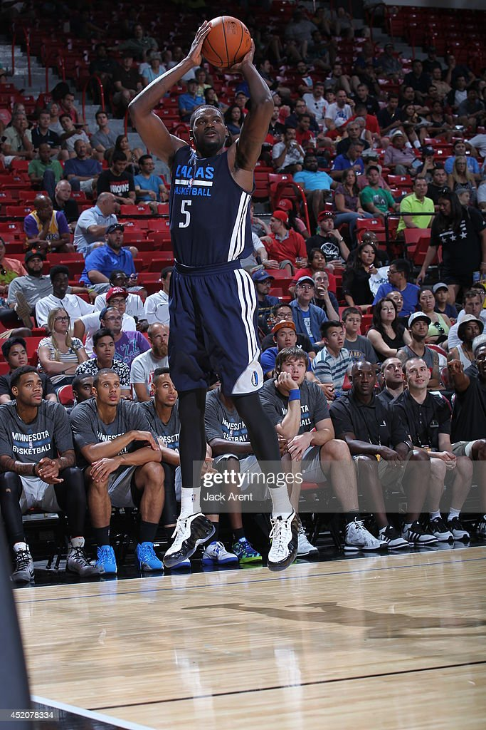 <a gi-track='captionPersonalityLinkClicked' href=/galleries/search?phrase=Bernard+James&family=editorial&specificpeople=7387529 ng-click='$event.stopPropagation()'>Bernard James</a> #5 of the Dallas Mavericks shoots the ball against the Minnesota Timberwolves at the Samsung NBA Summer League 2014 on July 12, 2014 at the Thomas & Mack Center in Las Vegas, Nevada.