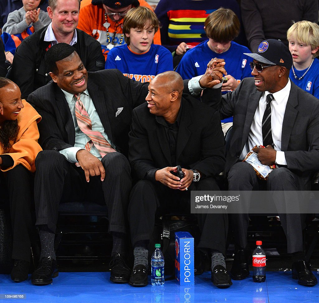 Bernard King, guest and JB Smoove attend the New Orleans Hornets vs New York Knicks game at Madison Square Garden on January 13, 2013 in New York City.