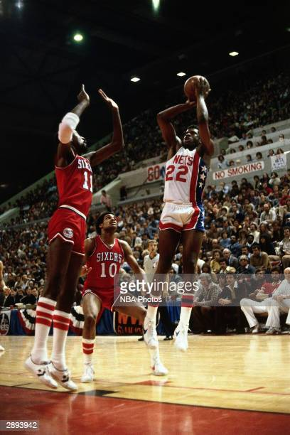 Bernard King of the New Jersey Nets shoots a jump shot during a game circa 1979 at Rutgers Athletic Center in Piscataway New Jersey NOTE TO USER User...