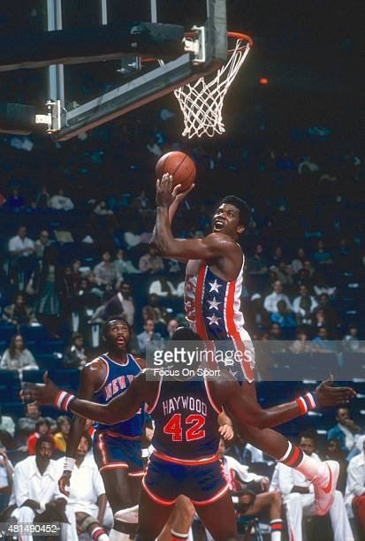 Bernard King of the New Jersey Nets shoots over Spencer Haywood of the New York Knicks during an NBA basketball game circa 1978 at the Rutgers...