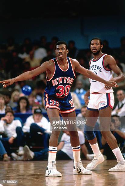Bernard King of the New York Knicks calls for the ball on the wing against the Los Angeles Clippers during an NBA game in 1984 at the LA Memorial...