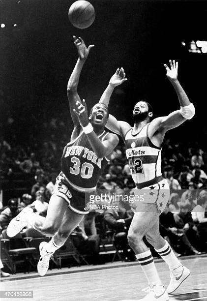 Bernard King of the New York Knicks drives against the New Jersey Nets circa 1985 at the Capital Centre in Landover Maryland NOTE TO USER User...