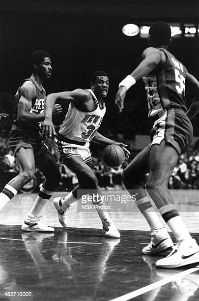 Bernard King of the New York Knicks drives against the New Jersey Nets circa 1982 at Madison Square Garden in New York City NY NOTE TO USER User...