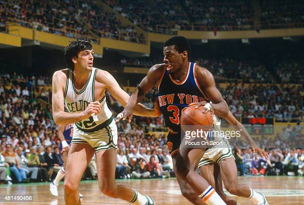 Bernard King of the New York Knicks Drives on Kevin McHale of the Boston Celtics during an NBA basketball game circa 1982 at the Boston Garden in...
