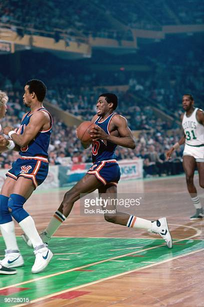 Bernard King of the New York Knicks drives to the basket against the Boston Celtics during a game played in 1984 at the Boston Garden in Boston...