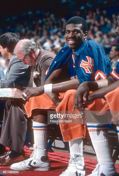 Bernard King of the New York Knicks looks on from the bench against the Washington Bullets during an NBA basketball game circa 1985 at the Capital...