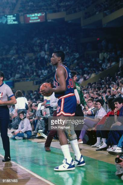 Bernard King of the New York Knicks looks to in bound the ball against the Boston Celtics during a game played in 1987 at the Boston Garden in Boston...