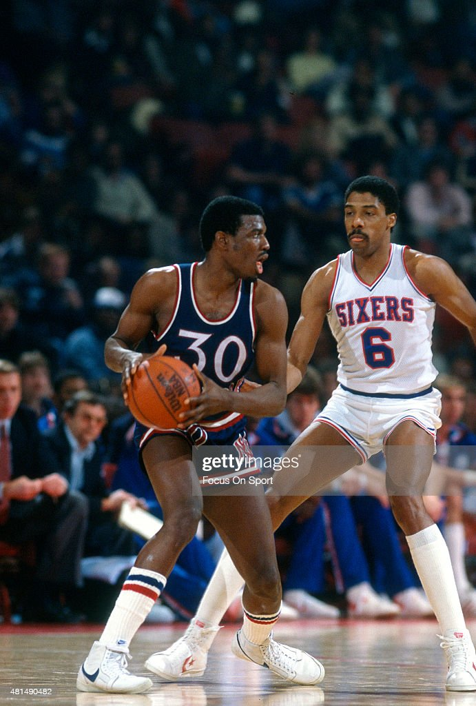 <a gi-track='captionPersonalityLinkClicked' href=/galleries/search?phrase=Bernard+King&family=editorial&specificpeople=214248 ng-click='$event.stopPropagation()'>Bernard King</a> #30 of the New York Knicks looks to put a move on <a gi-track='captionPersonalityLinkClicked' href=/galleries/search?phrase=Julius+Erving&family=editorial&specificpeople=202966 ng-click='$event.stopPropagation()'>Julius Erving</a> #6 of the Philadelphia 76ers during an NBA basketball game circa 1983 at The Spectrum in Philadelphia, Pennsylvania. King played for the Knicks from 1982-87.