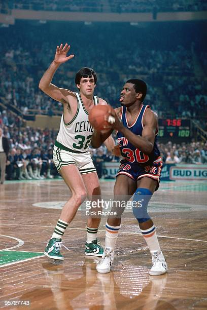 Bernard King of the New York Knicks makes a move against the Kevin McHale of the Boston Celtics during a game played in 1985 at the Boston Garden in...