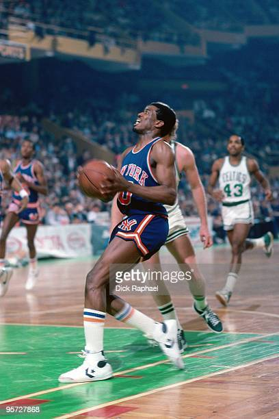 Bernard King of the New York Knicks makes a move to the basket against the Boston Celtics during a game played in 1984 at the Boston Garden in Boston...