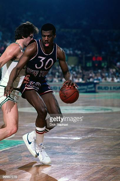Bernard King of the New York Knicks makes a move to the basket against the Boston Celtics during a game played in 1983 at the Boston Garden in Boston...