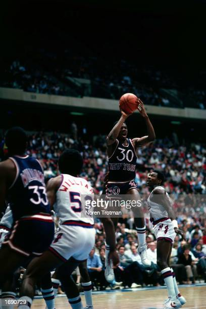 Bernard King of the New York Knicks makes a pass during the 1982 NBA game against the New Jersey Nets at the Brendan Byrne Arena in East Rutherford...