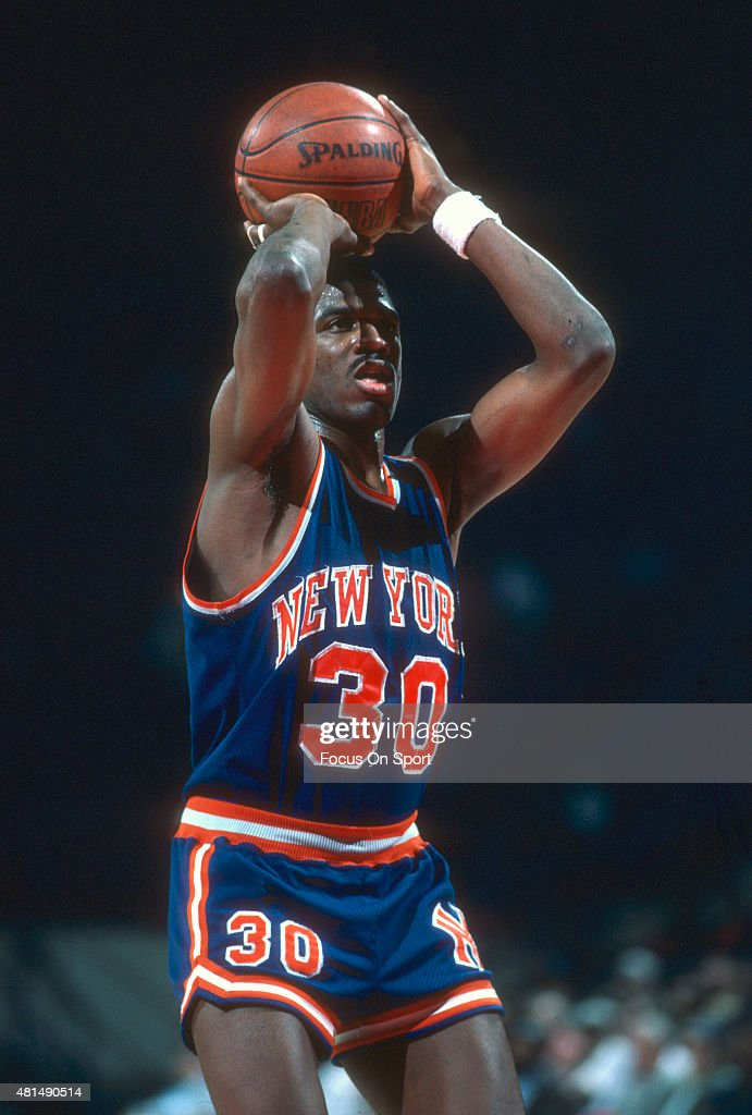 <a gi-track='captionPersonalityLinkClicked' href=/galleries/search?phrase=Bernard+King&family=editorial&specificpeople=214248 ng-click='$event.stopPropagation()'>Bernard King</a> #30 of the New York Knicks shoots a free throw against the Washington Bullets during an NBA basketball game circa 1985 at the Capital Centre in Landover, Maryland. King played for the Knicks from 1982-87.