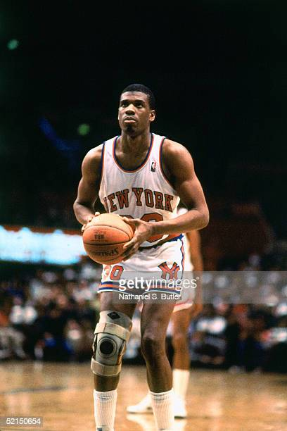 Bernard King of the New York Knicks shoots a free throw against the Milwaukee Bucks during an NBA game in 1986 at Madison Square Garden in New York...