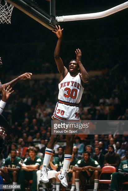 Bernard King of the New York Knicks shoots against the Boston Celtics during an NBA basketball game circa 1982 at Madison Square Garden in the...