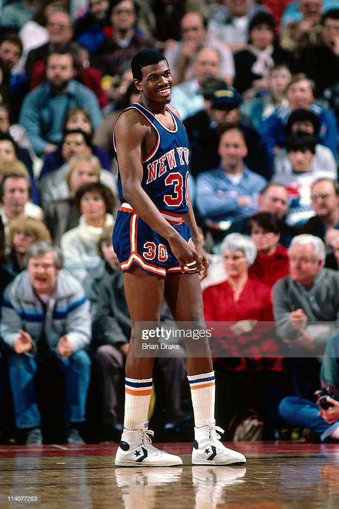 <a gi-track='captionPersonalityLinkClicked' href=/galleries/search?phrase=Bernard+King&family=editorial&specificpeople=214248 ng-click='$event.stopPropagation()'>Bernard King</a> #30 of the New York Knicks smiles against the Portland Trailbalzers at the Veterans Memorial Coliseum in Portland, Oregon circa 1984.