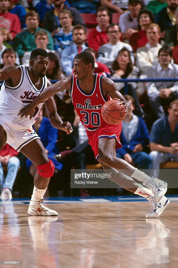 <a gi-track='captionPersonalityLinkClicked' href=/galleries/search?phrase=Bernard+King&family=editorial&specificpeople=214248 ng-click='$event.stopPropagation()'>Bernard King</a> #30 of the Washington Bullets dribbles the ball against the Sacramento Kings during a game played on December 6, 1990 at Arco Arena in Sacramento, California.