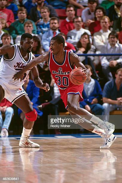 Bernard King of the Washington Bullets dribbles the ball against the Sacramento Kings during a game played on December 6 1990 at Arco Arena in...
