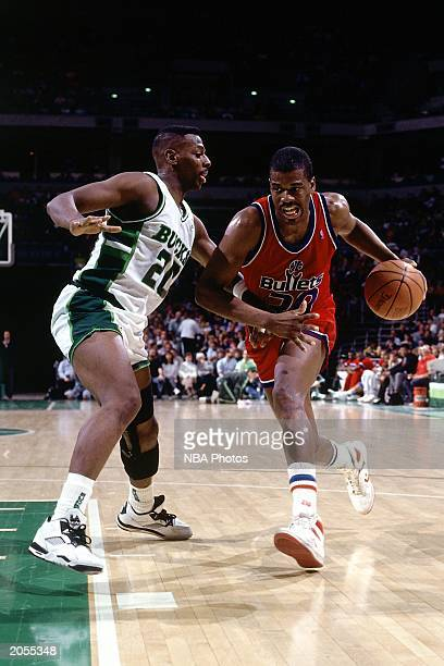Bernard King of the Washington Bullets drives against Jeff Grayer of the Milwaukee Bucks during a 1990 season NBA game at the Bradley Center in...