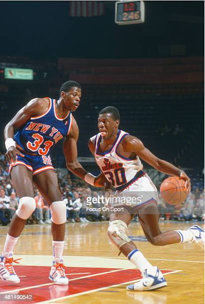 Bernard King of the Washington Bullets drives on Patrick Ewing of the New York Knicks during an NBA basketball game circa 1989 at the Capital Centre...