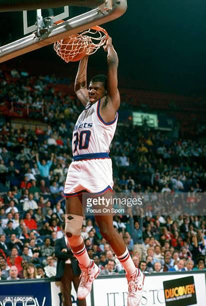 Bernard King of the Washington Bullets slam dunks the ball during an NBA basketball game circa 1989 at the Capital Centre in Landover Maryland King...