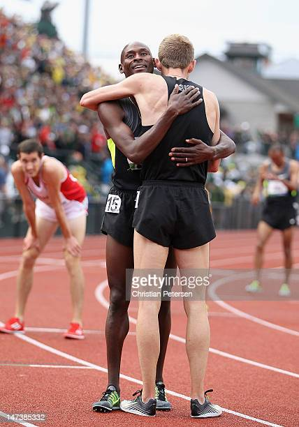 Bernard Lagat and Galen Rupp celebrates after finishing first and second in the Men's 5000 Meter Run on day seven of the US Olympic Track Field Team...