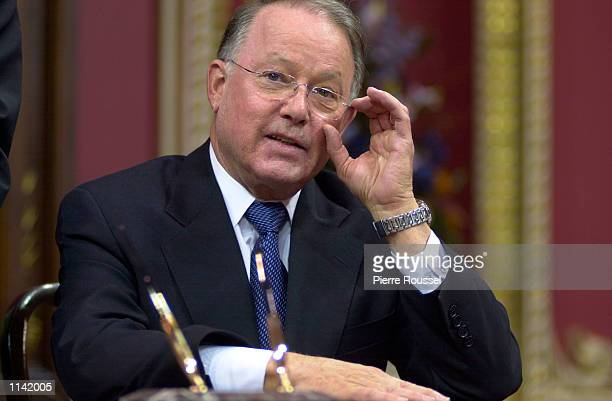 Bernard Landry adjusts his glasses after signing the papers to officially become the new Premier of the Canadian province of Quebec March 8 2001...
