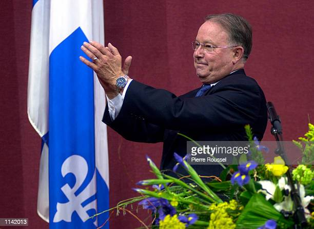 Bernard Landry applauds his new cabinet after being installed as Premier of the Canadian province of Quebec March 8 2001 during a ceremony at the...