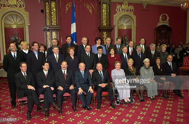 Bernard Landry first row center poses with his cabinet after being installed as the new Premier of the Canadian province of Quebec March 8 2001...