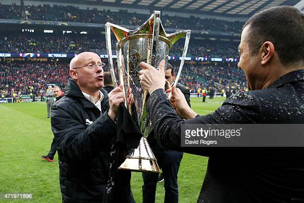 Bernard Laporte the head coach of Toulon aqnd Mourad Boudjellal the club owner of Toulon celebrate with the trophy following his team's victory...