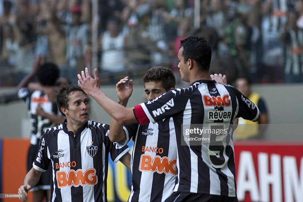 Bernard Leandro Donizete and Réver of Atlético MG celebrate a goal during a match between Atletico MG and Fluminense as part of Campeonato Brasileiro...