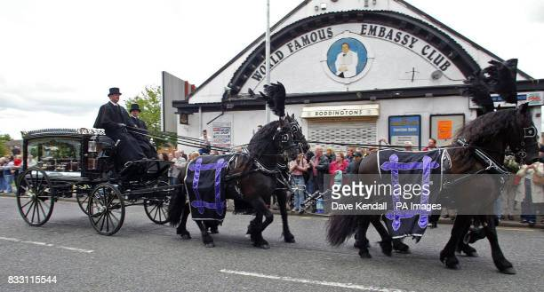 Bernard Manning's horse drawn hearse passes his world famous Embassy Club on Rochdale Road Manchester where crowds lined up to pay their last respects