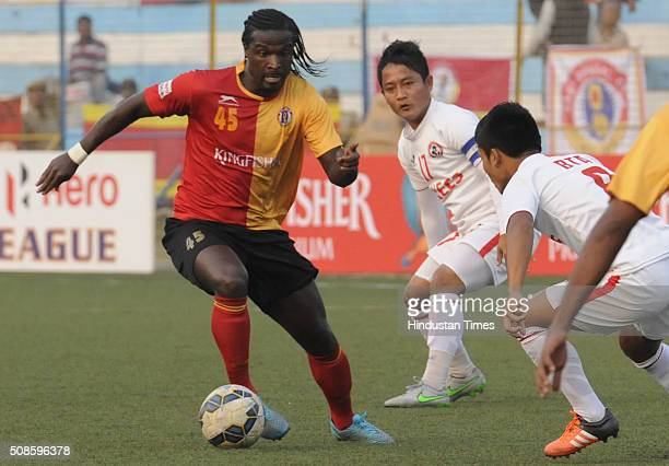 Bernard Mendy of East Bengal is trying to beat the Aizawl FC defenders during the I League match at Barasat Stadium on February 5 2016 in Kolkata...