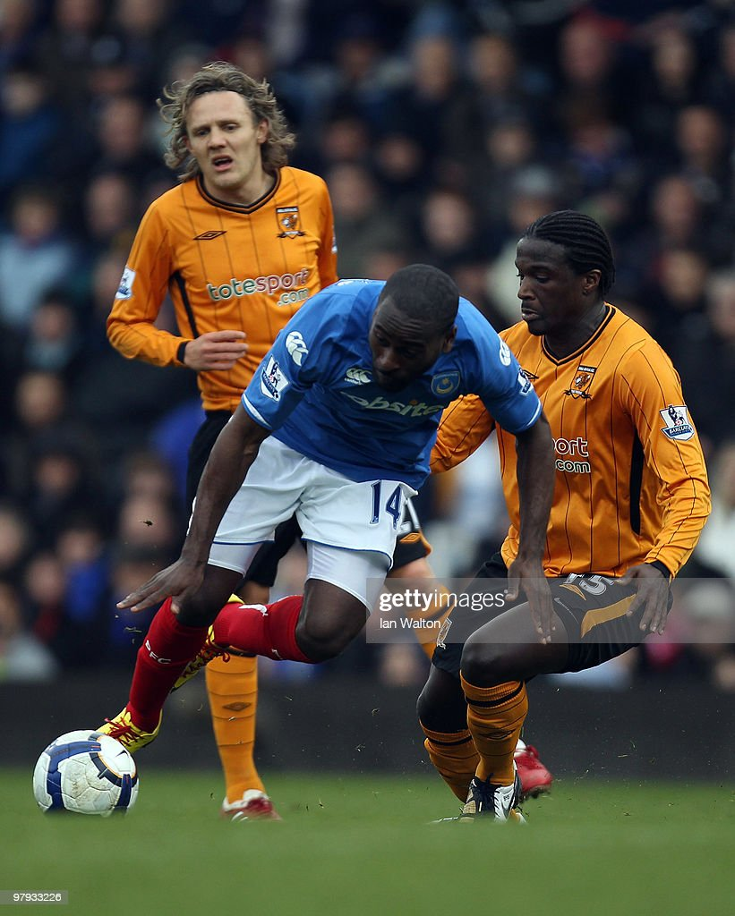 <a gi-track='captionPersonalityLinkClicked' href=/galleries/search?phrase=Bernard+Mendy&family=editorial&specificpeople=661868 ng-click='$event.stopPropagation()'>Bernard Mendy</a> of Hull City tries to tackle Quincy Owusu-Abeyie of Portsmouth in action during the Barclays Premier League match between Portsmouth and Sunderland at Fratton Park on March 20, 2010 in Portsmouth, England.