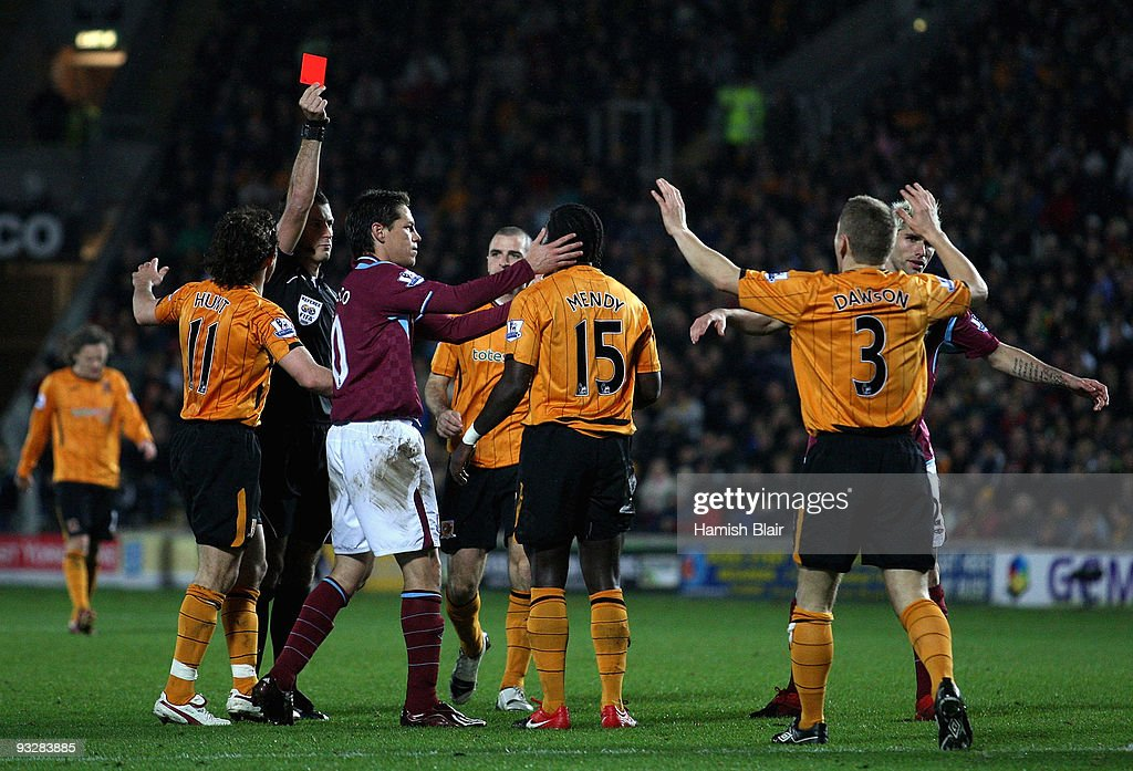 <a gi-track='captionPersonalityLinkClicked' href=/galleries/search?phrase=Bernard+Mendy&family=editorial&specificpeople=661868 ng-click='$event.stopPropagation()'>Bernard Mendy</a> of Hull is sent off by referee <a gi-track='captionPersonalityLinkClicked' href=/galleries/search?phrase=Mark+Clattenburg&family=editorial&specificpeople=2108870 ng-click='$event.stopPropagation()'>Mark Clattenburg</a> for a peofessional on Scott Parker of West Ham during the Barclays Premier League match between Hull City and West Ham United at the KC Stadium on November 21, 2009 in Hull, England.