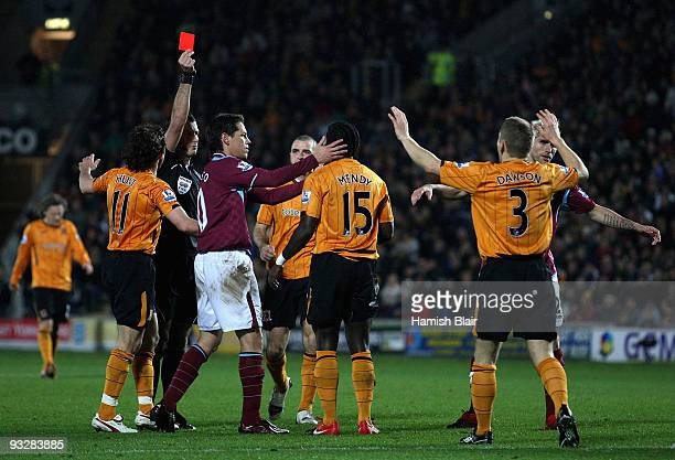 Bernard Mendy of Hull is sent off by referee Mark Clattenburg for a peofessional on Scott Parker of West Ham during the Barclays Premier League match...