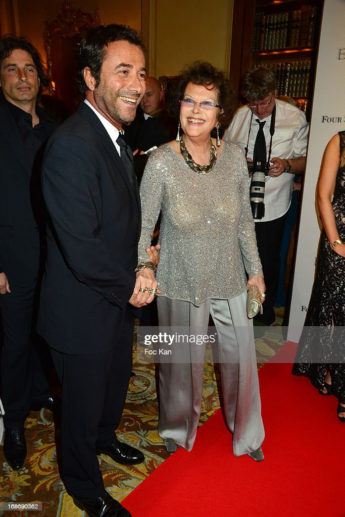 Bernard Montiel and Claudia Cardinale attend the Eva Longoria Presents 'Global Gift Gala' 2013 - Photocall at the Hotel Four Season GeorgesV on May 13, 2013 in Paris, France.